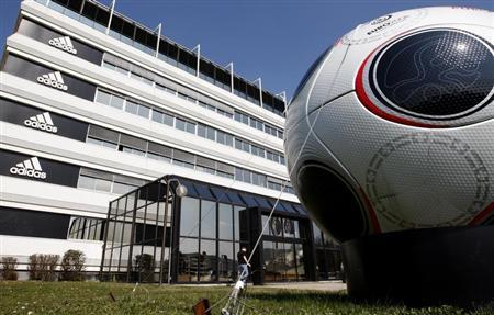 A giant soccer ball is seen in front of the main entrance of the Adidas building in Landersheim near Strasbourg March 31, 2009. REUTERS/Christian Hartmann