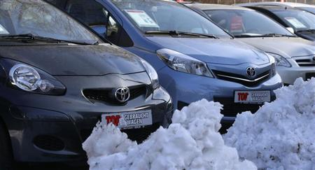 Piles of snow are seen next to parked cars at the yard of a car dealer in Berlin's Weissensee district March 26, 2013. REUTERS/Tobias Schwarz