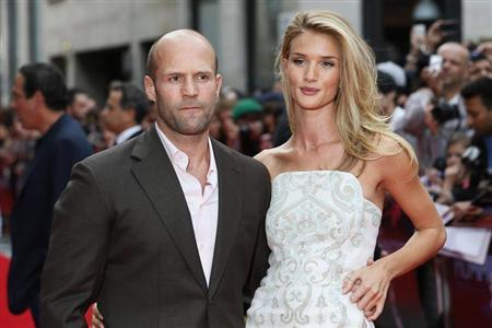 Actor Jason Statham arrives with his girlfriend Rosie Huntington-Whiteley for the world premiere of ''Hummingbird'', at Leicester Square in central London June 17, 2013. REUTERS/Stefan Wermuth