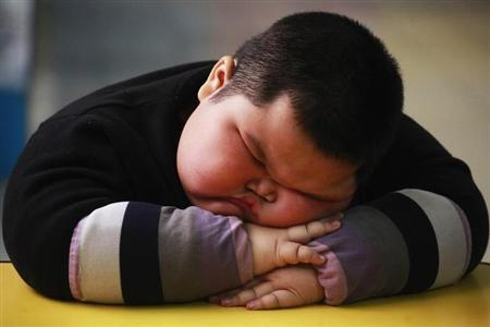 Lu Zhihao, 4, takes a nap at a kindergarten in Foshan, Guangdong province March 29, 2011. REUTERS/Joe Tan/Files