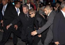"""Singer Justin Bieber (C) arrives late for the premiere of the film """"After Earth"""" in New York May 29, 2013. REUTERS/Carlo Allegri"""