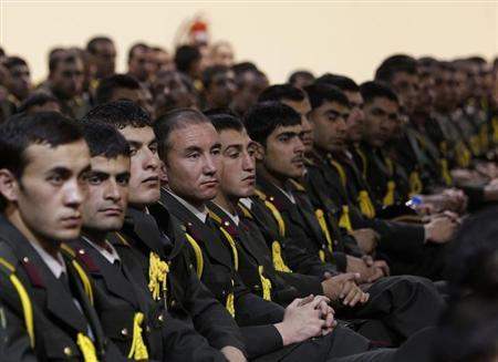 Afghan defence officers attend a security handover ceremony at a military academy outside Kabul June 18, 2013. Afghanistan will send a team to Qatar for peace talks with the Taliban, President Hamid Karzai said on Tuesday, as the U.S.-led NATO coalition launched the final phase of the 12-year war with the last round of security transfers to Afghan forces. REUTERS/Omar Sobhani
