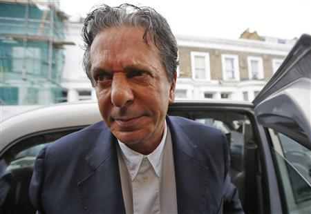 Art collector Charles Saatchi arrives at his home in west London June 18, 2013. REUTERS/Olivia Harris