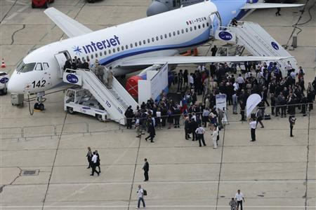 An aerial view shows visitors gathering near an Interjet Sukhoi SuperJet 100 during the 50th Paris Air Show, at Le Bourget airport near Paris, June 18, 2013. REUTERS/Pascal Rossignol