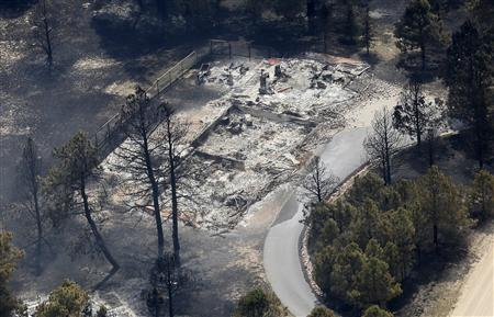 An aerial view of a destroyed house in the aftermath of the Black Forest Fire in Black Forest, Colorado June 13, 2013. REUTERS/Rick Wilking