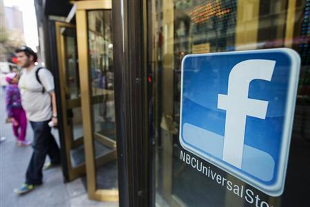 A Facebook logo is attached to the windows of the NBC store inside of Rockefeller Center in New York April 30, 2013. REUTERS/Lucas Jackson/Files