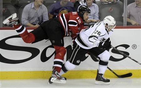 Los Angeles Kings' Slava Voynov (R) checks New Jersey Devils' Alexei Ponikarovsky during the second period in Game 1 of the NHL Stanley Cup hockey final in Newark, New Jersey, May 30, 2012. REUTERS/Ray Stubblebine