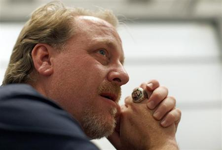 Former MLB player Curt Schilling talks with a reporter at the Electronic Entertainment Expo, or E3, in Los Angeles, California June 9, 2011. REUTERS/David McNew