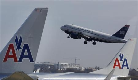A U.S. Airways jet departs Washington's Reagan National Airport next to American Airlines jets outside Washington, February 25, 2013. REUTERS/Larry Downing