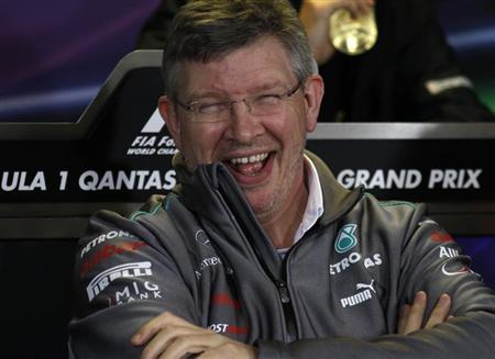 Mercedes Formula One team principal Ross Brawn laughs during a new conference following the second practice session of the Australian F1 Grand Prix at the Albert Park circuit in Melbourne March 16, 2012. REUTERS/Brandon Malone