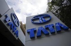 Tata Motors logos are seen at their flagship showroom in Mumbai February 14, 2013. REUTERS/Vivek Prakash