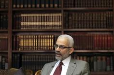 Alaa Abdel Aziz, Egypt's new culture minister, speaks during an interview in Cairo, June 17, 2013. REUTERS/Mohamed Abd El Ghany