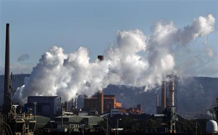Vapour pours from a steel mill chimney in the industrial town of Port Kembla, about 80 km (50 miles) south of Sydney July 7, 2011. REUTERS/Tim Wimborne/FILE PHOTO