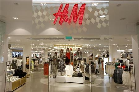The company logo is placed at the flagship store of H&M, Hennes & Mauritz, HMb.ST, the world's second-biggest fashion retailer in Sweden's capital Stockholm May 7, 2013. REUTERS/Arnd Wiegmann