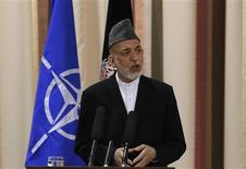 Afghan President Hamid Karzai speaks during a joint news conference with NATO Secretary General Anders Fogh Rasmussen following a security handover ceremony at a military academy outside Kabul June 18, 2013. REUTERS/Omar Sobhani