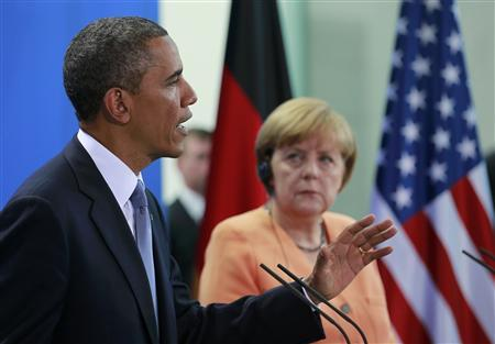 U.S. President Barack Obama speaks next to German Chancellor Angela Merkel during a news conference after their meeting at the Chancellery in Berlin, June 19, 2013. REUTERS/Thomas Peter