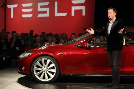 Tesla Motors CEO Elon Musk speaks next to the company's newest Model S during the Model S Beta Event held at the Tesla factory in Fremont, California October 1, 2011. REUTERS/Stephen Lam