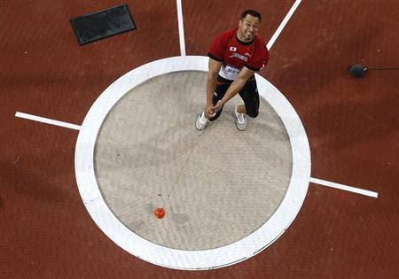 Japan's Koji Murofushi competes in the men's hammer throw final during the London 2012 Olympic Games at the Olympic Stadium August 5, 2012. REUTERS/Reinhard Krause/Files