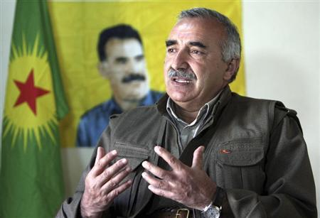 Murat Karayilan, acting military commander of the Kurdistan Workers Party (PKK), speaks during an interview with Reuters at the Qandil mountains near the Iraq-Turkish border in Sulaimaniya, 330 km (205 miles) northeast of Baghdad March 24, 2013. REUTERS/Azad Lashkari