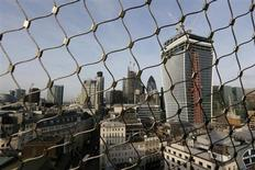 The City of London business district is seen through a wire fence in London February 28, 2013. REUTERS/Stefan Wermuth