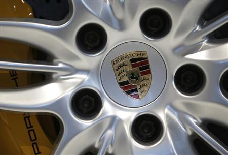 A logo is seen on a wheel of a Porsche 911 Carrera 4S ahead of the annual news conference at the Porsche headquarters in Stuttgart March 15, 2013. REUTERS/Lisi Niesner
