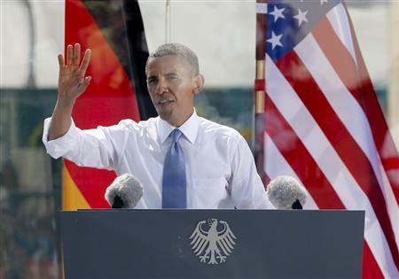 U.S. President Barack Obama speaks from behind a bulletproof glass at the Brandenburg Gate in Berlin, June 19, 2013. REUTERS/Fabrizio Bensch