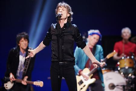 Mick Jagger (2nd L) performs with Ronnie Wood (rear L-R), Keith Richards and Charlie Watts of the Rolling Stones at a concert during the band's ''50 and Counting'' tour in Chicago May 28, 2013. REUTERS/John Gress