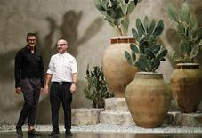 Italian designers Domenico Dolce (R) and Stefano Gabbana acknowledge the audience at the end of their Spring/Summer 2013 collection at Milan Fashion Week September 23, 2012 file photo. REUTERS/Stefano Rellandini