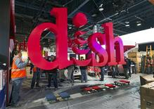 Workers build a booth for Dish, a satellite TV provider, as they prepare for the International CES show at the Las Vegas Convention Center in Las Vegas, Nevada January 4, 2013. REUTERS/Steve Marcus