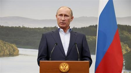 Russia's President Vladimir Putin gestures during a media conference after a G8 summit at the Lough Erne golf resort in Enniskillen, Northern Ireland June 18, 2013. REUTERS/Matt Dunham/Pool