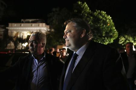 PASOK Socialist party leader Evangelos Venizelos (C), junior partner in Greece's ruling coalition, leaves the Prime Minister's office in Athens June 17, 2013. REUTERS/Yorgos Karahalis