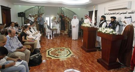 Muhammad Naeem (2nd R), a spokesman for the Office of the Taliban of Afghanistan, stands next to a translator speaking during the opening of the Taliban Afghanistan Political Office in Doha June 18, 2013. REUTERS/Mohammed Dabbous
