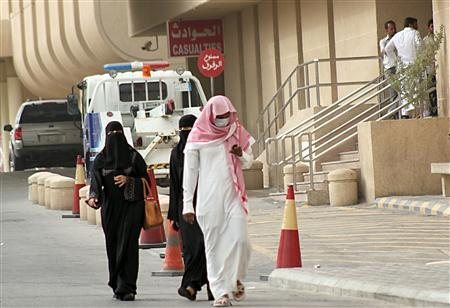 A man, wearing a surgical mask as a precautionary measure against the novel coronavirus, walks near a hospital in Khobar city in Dammam May 21, 2013. REUTERS/Stringer