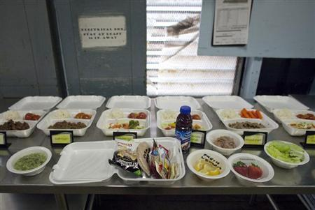 A selection of lunch meals offered to detainees are displayed in a food preparation area at the U.S. Naval Base at Guantanamo Bay, March 7, 2013. REUTERS/Bob Strong