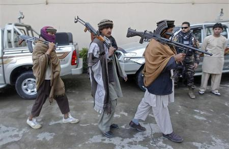 Members of the Taliban voluntarily hand over their weapons and join a peace reconciliation program in Jalalabad province January 6, 2013. REUTERS/Parwiz/Files