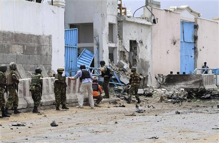 Security agents arrive to secure the United Nations compound following a suicide bomb attack in the capital Mogadishu, June 19, 2013. REUTERS/Omar Faruk
