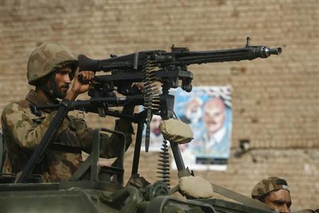 An army soldier patrols in Bara sheikhan, Peshawar May 10, 2013. REUTERS/Khuram Parvez/Files