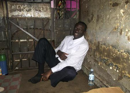 Ugandan opposition leader Kizza Besigye sits in a police cell in Uganda's capital Kampala January 19, 2012. REUTERS/Courtesy FDC/Handout