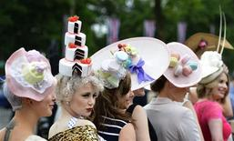 Racegoers pose for photographers as they arrive for Ladies' Day at the Royal Ascot horse racing festival at Ascot, southern England June 20, 2013. REUTERS/Toby Melville