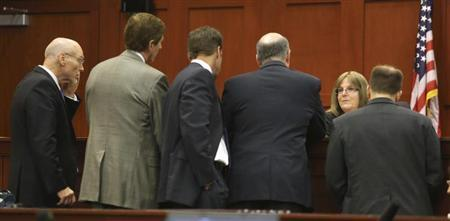 Judge Debra Nelson huddles with the defense and the prosecution teams during the second day of jury selection in the murder trial of George Zimmerman, who shot and killed unarmed black teenager Trayvon Martin in 2012, at Seminole circuit court in Sanford, Florida, June 11, 2013. REUTERS/Joe Burbank/Pool