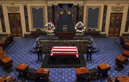 The flag-draped casket of the late Senator Frank Lautenberg (D-NJ) lies in repose in the Senate chamber on Capitol Hill in Washington, June 6, 2013. REUTERS/Bill O'Leary/Pool