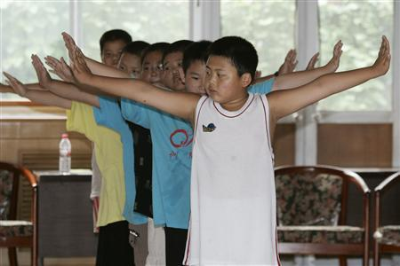 Boys exercise at OK Slim summer camp on the outskirts of Beijing in this August 3, 2006 file photo. REUTERS/Claro Cortes IV