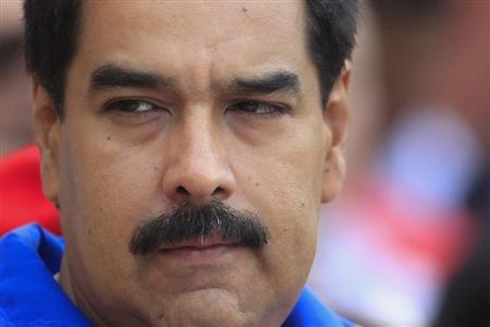Venezuelan President Nicolas Maduro reacts while attending a mass at the mausoleum of late President Hugo Chavez to mark three months after his death in Caracas, June 5, 2013. REUTERS/Jorge Silva