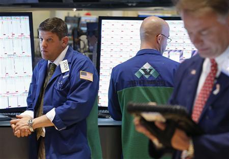 Traders work on the floor at the New York Stock Exchange, June 20, 2013. REUTERS/Brendan McDermid