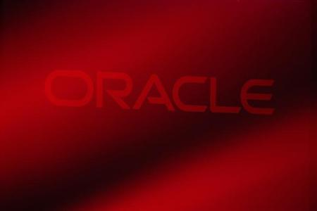 An Oracle Corporation logo is seen on stage prior to the announcement of the company's latest SPARC servers at Oracle Conference Center in Redwood Shores, California March 26, 2013. REUTERS/Stephen Lam/Files