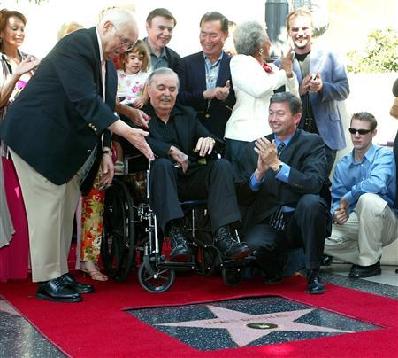 James Doohan, (C) who played ''Scotty'' in the 1960's TV series 'Star Trek,' receives his star on the famous Hollywood Walk of Fame as fans, friends, family and members of the from the original cast came out to honor him on August 31, 2004. REUTERS/Gene Blevins