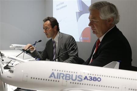 Airbus' Chairman and CEO Fabrice Bregier (L) and Airbus sales chief John Leahy attend a final news conference at the 50th Paris Air Show, at the Le Bourget airport near Paris, June 20, 2013. REUTERS/Pascal Rossignol