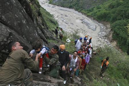 Soldiers rescue stranded people after heavy rains in the Himalayan state of Uttarakhand June 18, 2013. REUTERS/Stringer