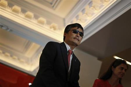 Chinese dissident Chen Guangcheng speaks to journalists following an appearance in New York May 3, 2013. REUTERS/Brendan McDermid