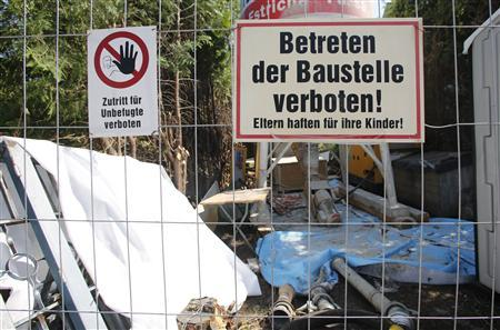 The garden of the house of Josef Fritzl, who kept his daughter captive for 24 years and fathered seven children in the cellar, is filled with building materials, in the village of Amstetten June 21, 2013. The cellar is being sealed off with concrete, much to the relief of neighbours keen to forget one of Austria's most horrific crimes. Fritzl, was sentenced in 2009 to life imprisonment in a special unit for the criminally insane for incest, rape, coercion, false imprisonment, enslavement and for the negligent homicide of one of his infant sons. REUTERS/Leonhard Foeger